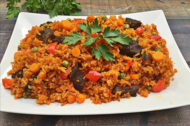 West african jollof rice feastt jollof rice is a great favorite all over west africa the name jollof rice is derived from the name of the wolof people in some places jollof rice is ccuart Choice Image
